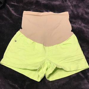 Lime green maternity shorts.